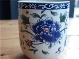 Porcelain cup with blue flowers
